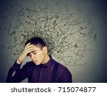 thoughtful stressed man with a... | Shutterstock . vector #715074877