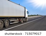 truck on road with clear... | Shutterstock . vector #715079017