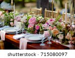 served table next to the decor. ... | Shutterstock . vector #715080097