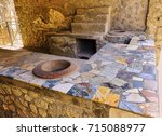 Small photo of Thermopolium of archaeological remains of Via della Abbondanza street at Ruins of Pompeii. The city was an ancient Roman city destroyed by the volcano Vesuvius. Pompei, Campania, Italy.