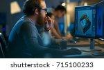 male game developer works on a... | Shutterstock . vector #715100233
