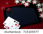 Small photo of Internet casino and online gambling concept with two cards (aces) on a digital tablet, dice used to play the game of craps, black and red poker chips and copy space on the surface of electronic pad