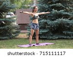 young sporty woman doing... | Shutterstock . vector #715111117