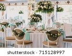 dinner tables with mint clothes ... | Shutterstock . vector #715128997