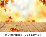 autumn maple leaves on wooden ... | Shutterstock . vector #715139497