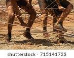 mud race runners racers... | Shutterstock . vector #715141723