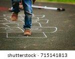 little boy playing hopscotch on ... | Shutterstock . vector #715141813