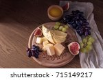 cheese board with grapes  figs... | Shutterstock . vector #715149217