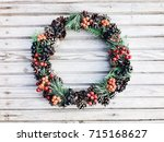 christmas wreath on the wooden...   Shutterstock . vector #715168627