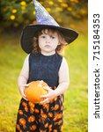 halloween concept  toddler girl ... | Shutterstock . vector #715184353