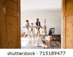 young couple moving in new... | Shutterstock . vector #715189477