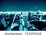 abstract city light bokeh... | Shutterstock . vector #715193143