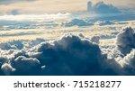 cloud from plane window view. | Shutterstock . vector #715218277