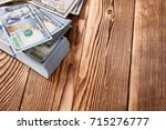 money isolated on a wooden... | Shutterstock . vector #715276777