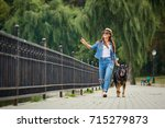 a young girl is walking with a  ... | Shutterstock . vector #715279873