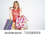 pretty girl with shopping bags | Shutterstock . vector #715283353