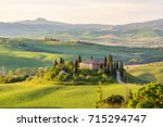 house on a hill in tuscany... | Shutterstock . vector #715294747