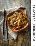 korean japchae vegetarian stir... | Shutterstock . vector #715314463