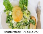 fresh organic caesar salad with ... | Shutterstock . vector #715315297