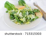 fresh organic caesar salad with ... | Shutterstock . vector #715315303
