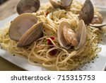 spaghetti with fresh cooked... | Shutterstock . vector #715315753