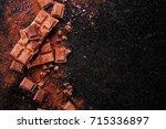 broken chocolate pieces and... | Shutterstock . vector #715336897