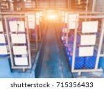 blurred warehouse or storehouse ... | Shutterstock . vector #715356433