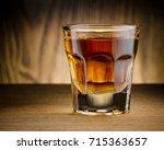 single whisky shots on wooden...   Shutterstock . vector #715363657