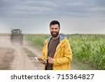 young farmer with beard holding ... | Shutterstock . vector #715364827