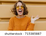 enthusiastic smiling girl with... | Shutterstock . vector #715385887