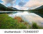 beautiful sunrise at kenai... | Shutterstock . vector #715400557