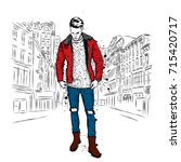 handsome guy in stylish clothes.... | Shutterstock .eps vector #715420717