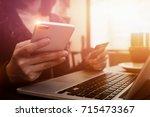 online payment woman's hands...   Shutterstock . vector #715473367