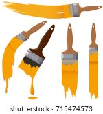 Paintbrushes With Yellow Paint...