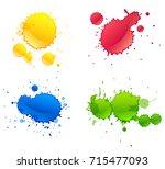 four different colors paints... | Shutterstock .eps vector #715477093