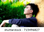 portrait a boring or thinking... | Shutterstock . vector #715496827