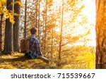 a young guy with a backpack... | Shutterstock . vector #715539667