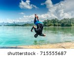 Tourist Man Jumping Back...