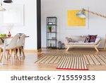patterned carpet on wooden...   Shutterstock . vector #715559353