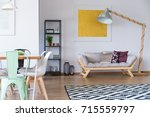mint chair in living room with... | Shutterstock . vector #715559797