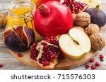 autumn harvest concept   fruits ... | Shutterstock . vector #715576303
