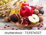 autumn harvest concept   fruits ... | Shutterstock . vector #715576327