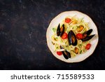 seafood fettuccine pasta with...   Shutterstock . vector #715589533