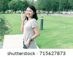 portrait of a asian woman with... | Shutterstock . vector #715627873