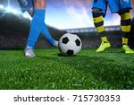 soccer player with ball in... | Shutterstock . vector #715730353