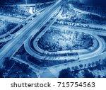overpass of the light trails ... | Shutterstock . vector #715754563