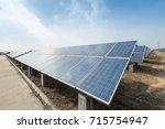 solar panels against blue sky | Shutterstock . vector #715754947