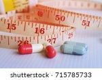 diet concept  slimming by slim... | Shutterstock . vector #715785733