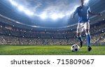 soccer player kicks the ball on ... | Shutterstock . vector #715809067