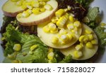 sliced apples with vegetable... | Shutterstock . vector #715828027